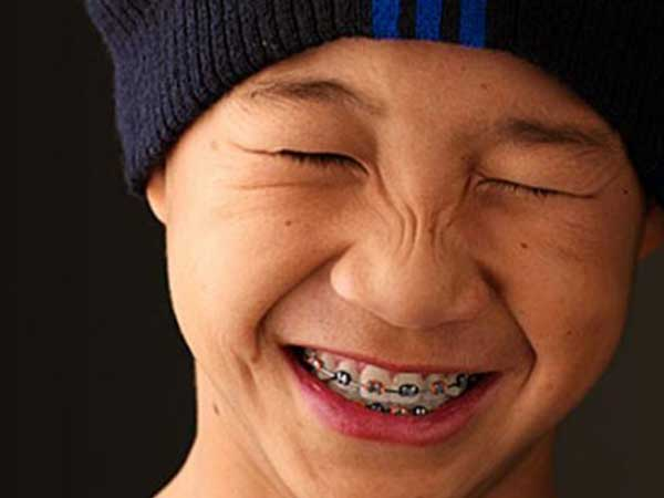Boy Wearing Metal Braces