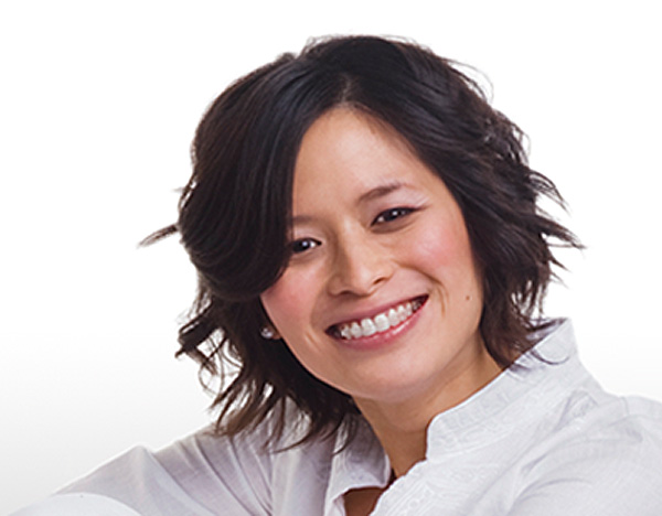 smiling woman wearing damon system clear braces