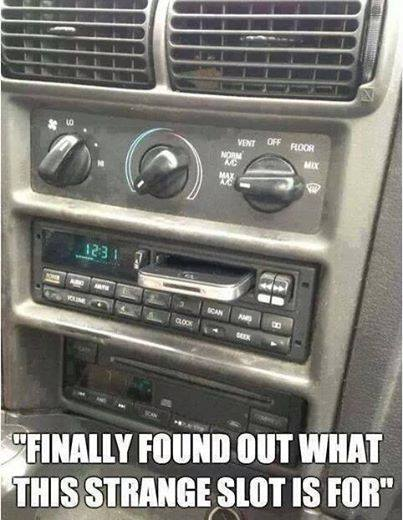 iphone in car's cassette tape slot.