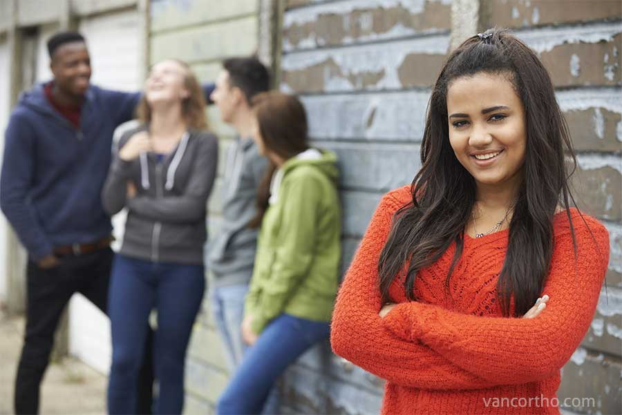 smiling teen girl with friends