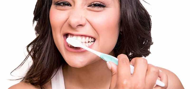 Teen girl brushing teeth