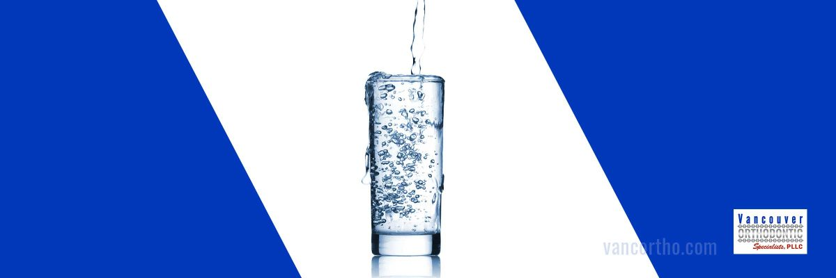 Glass of water representing a dry mouth solution
