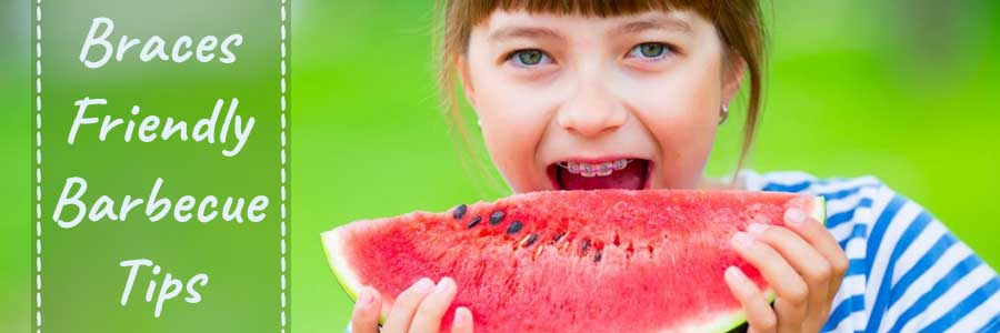 Girl wearing braces eating watermelon