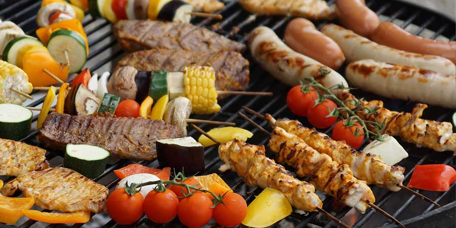 meats and veggies on the barbecue grill for 4th of July