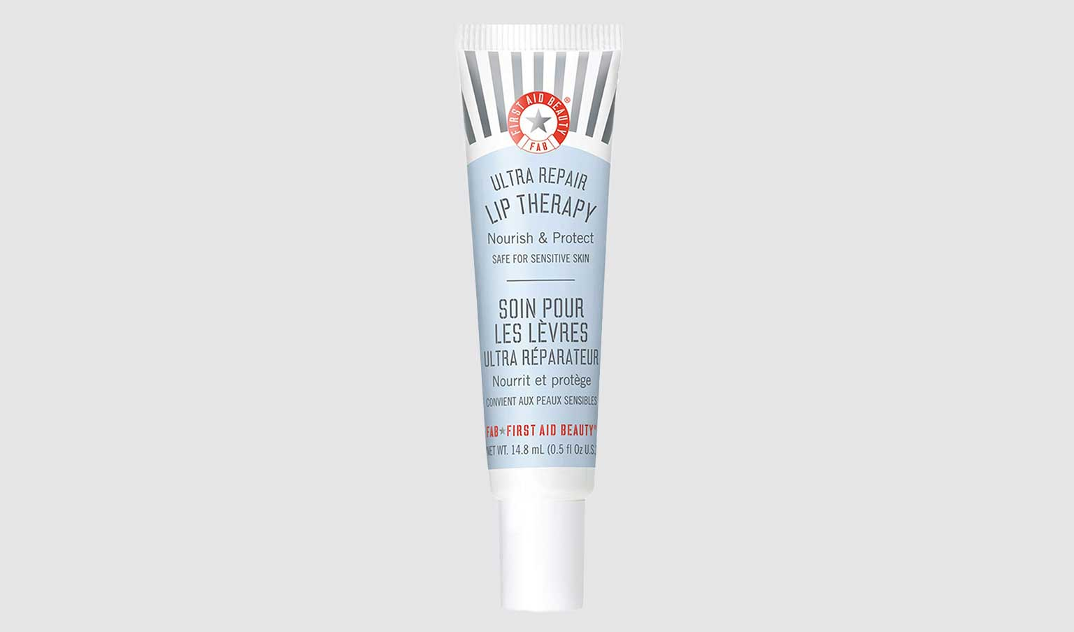 A tube of First Aid Beauty displayed on a light background