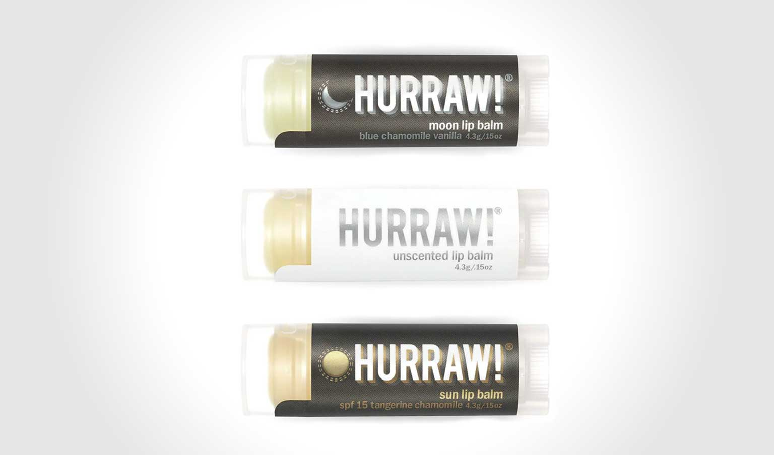 3 varieties of Hurraw! lip balm on light gradient background