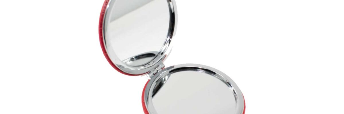 red compact mirror for your braces survival kit
